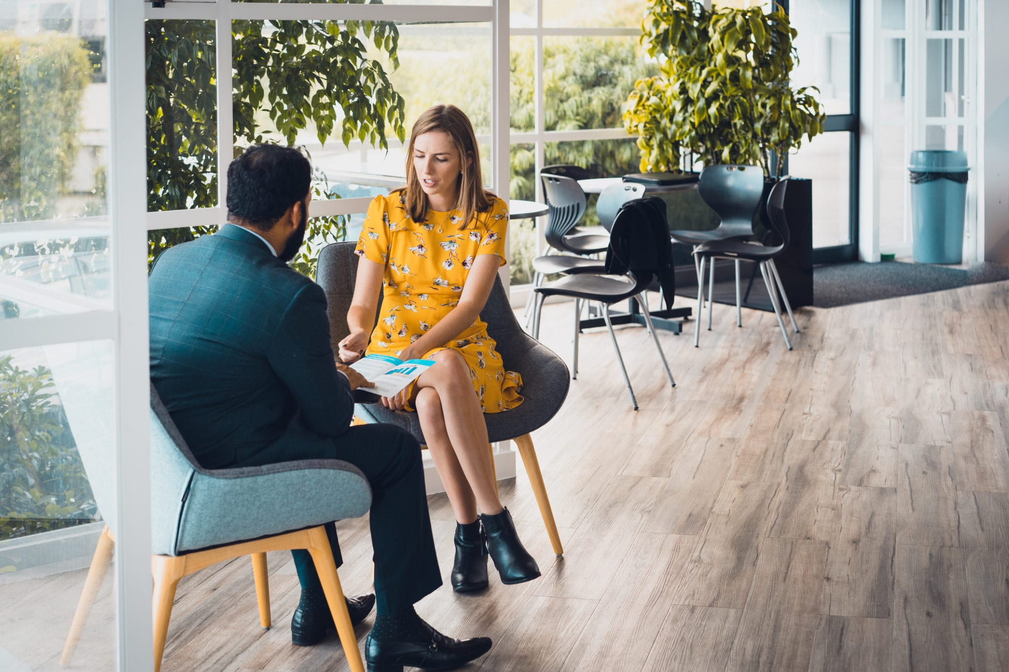 Man and woman have a business meeting in a small office