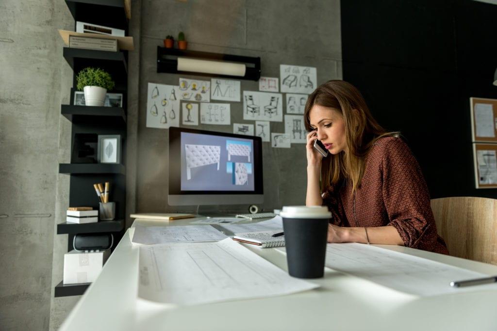 Interior designer working in her studio